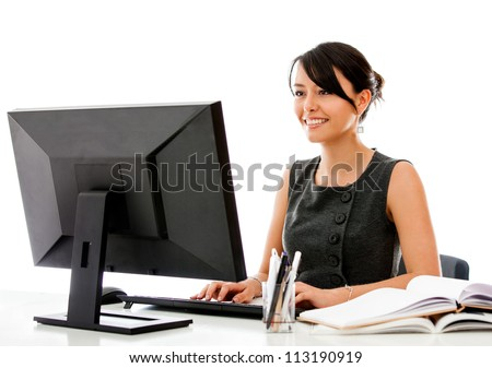 Business woman working at the office with a desktop computer