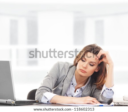Business woman working in office on white