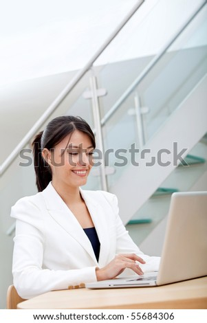 Business woman working on a laptop at the office