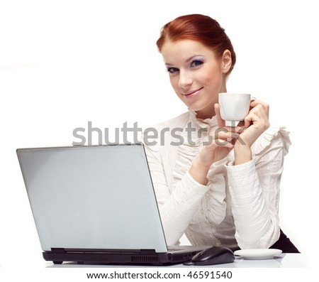 Business woman working on her laptop and drinking coffee.