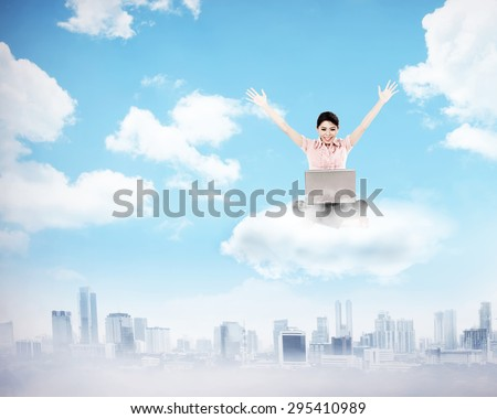 Business woman working on the cloud above the city. Cloud computing concept