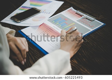 Business woman working with analysis marketing document . #605221493