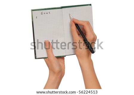 business woman writes goals for business plan