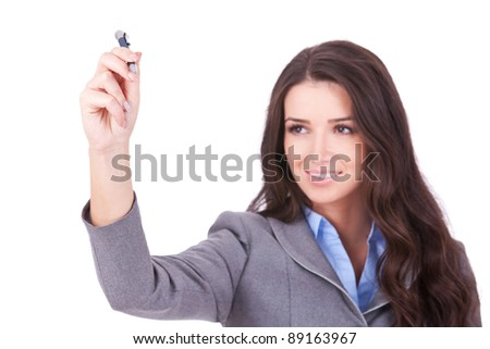 Business woman writing something with a  marker on white background