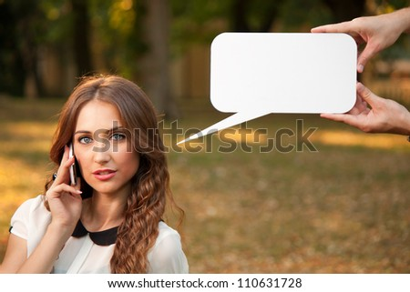 Business womanl talking with cell phone in park