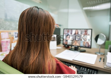 Business women are using computer laptop for video call with conference program concepts of online meetings or teaching students eLearning and work from home.
