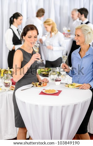 Business women drink aperitif during company seminar meeting