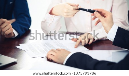 Business women giving a pen to businessman for contract signing. Agreement at negotiation or meeting. Success concept #1375793786