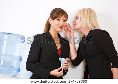 Business: Women Gossiping Around Water Cooler