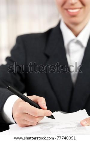 Business women hand pen writing paper document