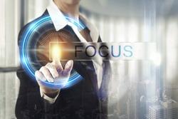 Business women touching the focus screen