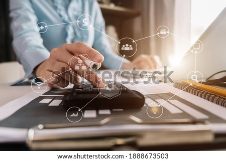 Business women working on desk office with using a calculator to calculate the numbers, finance accounting concept. Foto stock ©