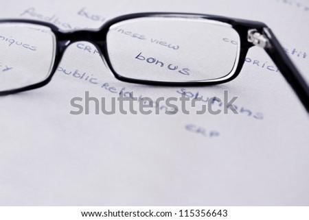 business words with glasses focusing on bonus