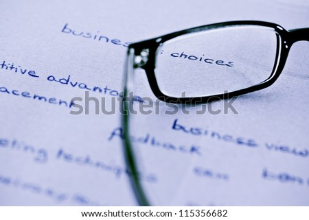 business words with glasses focusing on business choices