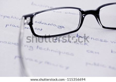 business words with glasses focusing on competitive advantage