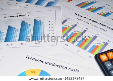 Business work, document data, graphs, graphs, marketing reports, research, development and planning for management, strategy analysis, financial accounting Business concepts in the future world #1452395489