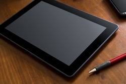 Business Work With Tablet & Smartphone On A Wooden Table