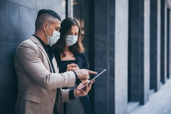 business worker with mask, businessman talking together with partner for marketing plan, coronavirus COVID-19 protection concept, new normal lifestyle