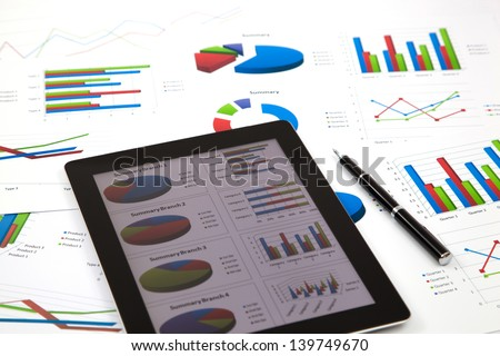 business workplace with stock market data