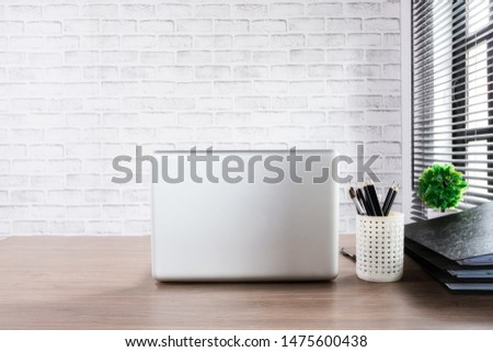 Business workspace with laptop computer and office supplies. Office desk concept. #1475600438