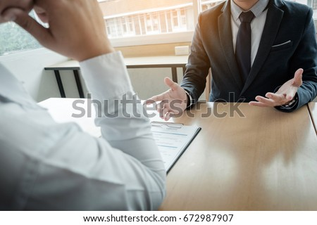 Business - young man explaining about his profile to business managers sitting in job Interview.