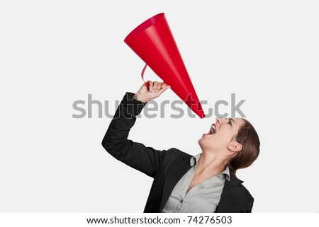 Business young woman speaking to a megaphone, isolated on white