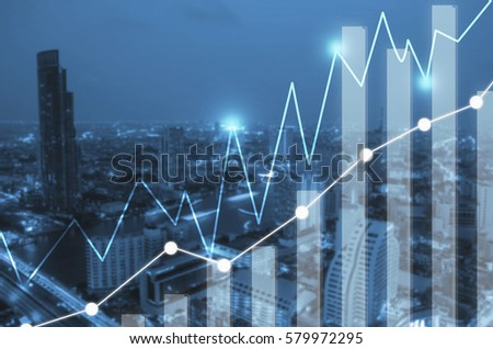Businesses concept photo of double exposure style with building and river at metropolis in night time and business graph or chart   #579972295