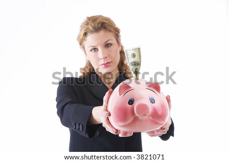 businesslady holding a piggybank with onehundred US dollar to the camera. Focus on piggybank, woman out of focus