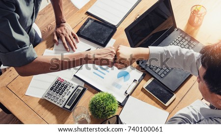Businessman a check data lots of number together teamwork, concept of teamwork of the businessman, Fist bump,Teamwork coordinated well understood and successful.