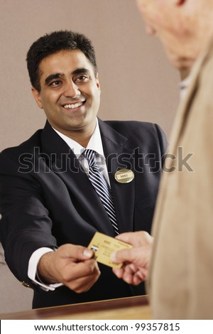 Businessman accepting credit card payment