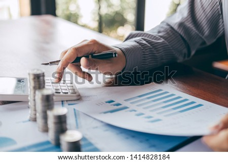 Businessman accountant counting money and making notes at report doing finances and calculate about cost of investment and analyzing financial data, Financing Accounting Banking Concept. #1414828184