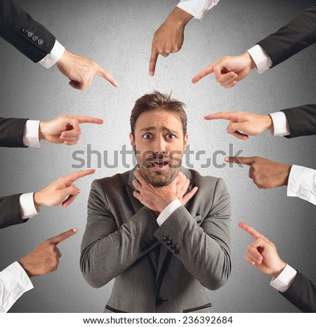 Shutterstock Businessman accused and insulted by his team
