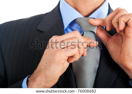 Businessman adjusting his collar isolated on white