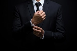 Businessman adjusting his cufflinks