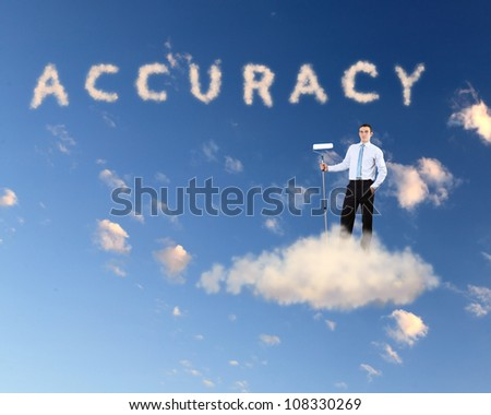 Businessman against blue sky with word accuracy writen