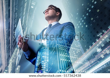 Businessman against buildings in business concept