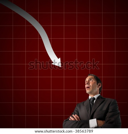 businessman against financial graphic with descendant arrow
