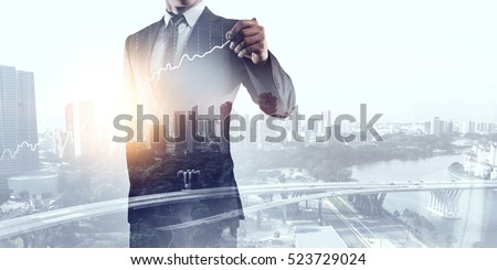 Businessman against modern city background . Mixed media #523729024