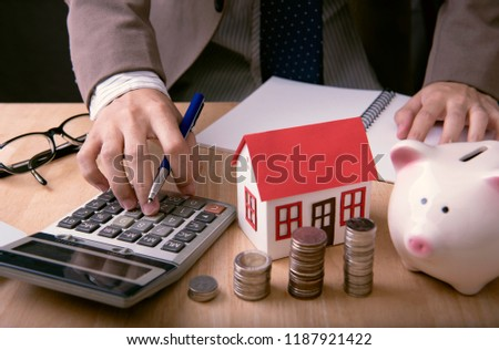 Businessman agent offer loan money and sale home. concept marketing house property.