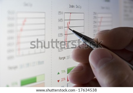Businessman analysing share prices on the stock market