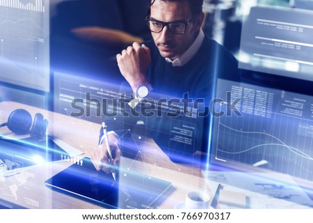 Businessman analysing the data on futuristic screen