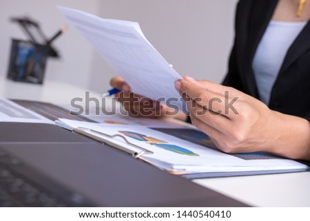 Businessman analysis comparing financial reports. Financial reports are set of documents prepared by an administrative team and ceo recheck report profit. Concept business finance