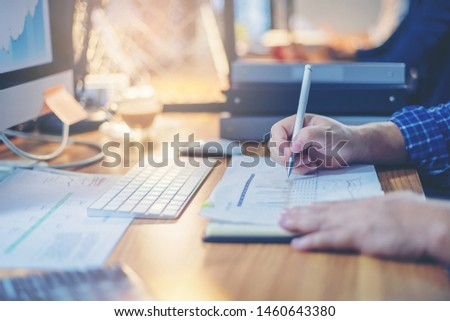 Businessman analyzing data together for planning and startup new project in workplace. Selected focus