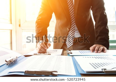 Businessman analyzing financial statements in the office