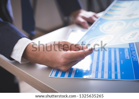 Businessman analyzing investment charts. Accounting #1325635265