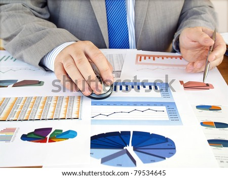 Businessman analyzing investment charts at his workplace