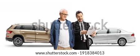 Businessman and a mature and looking at a tablet in a car showroom with SUV and car isolated on white background Сток-фото ©