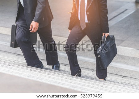 Businessman and Business woman up the stairs in a rush hour to work. Hurry time.