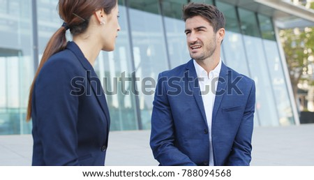 Businessman and businesswoman discuss together about the project planning