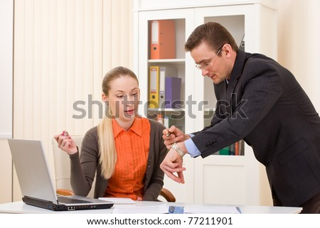 Businessman and businesswoman discuss working hours moments